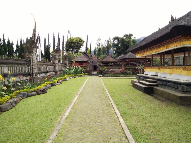 Architecture Building Exterior Built Structure City Day Diminishing Perspective Façade Grass Green Color Growth History Lawn Outdoors Plant Sky The Way Forward Tourism Travel Destinations Vanishing Point Bedugul Bali, Indonesia Bedugul Temple Bedugulbali