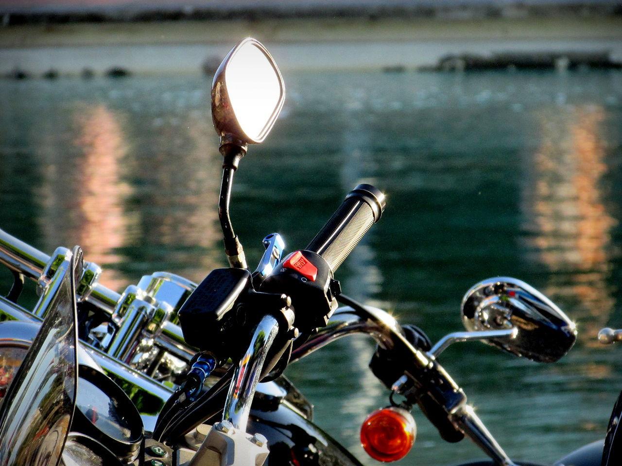 Mirror On Motorcycle Handlebar Against River