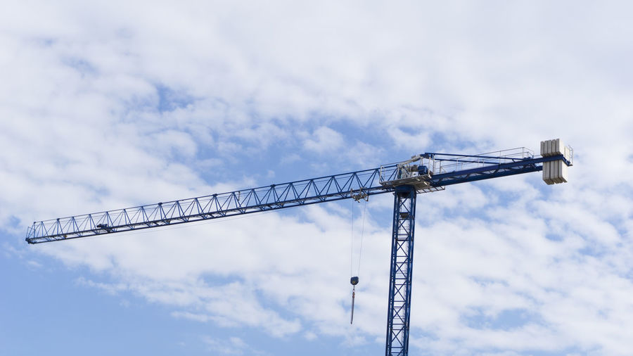 Isolated Crane, Cranes on Blue Sky With Clouds for Construction , Building , Real Estate , House Builder or Contractor by Ilarion Ananiev Crane Construction Excavator Cranes Tower Cranes Lifter Backgrounds Isolated Builder Construction Crane Industrial Commercial Residential  Under Tower Hydraulic Machinery Machine Engineering Cabin Equipment Concrete Hook Building Side View