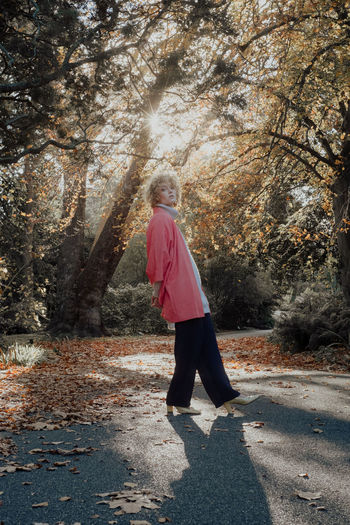 Autumn Beauty In Nature Casual Clothing Change Day Full Length Leaf Leisure Activity Lifestyles Nature One Person Outdoors People Real People Rear View Standing The Portraitist - 2017 EyeEm Awards Tree Walking Young Adult Young Women