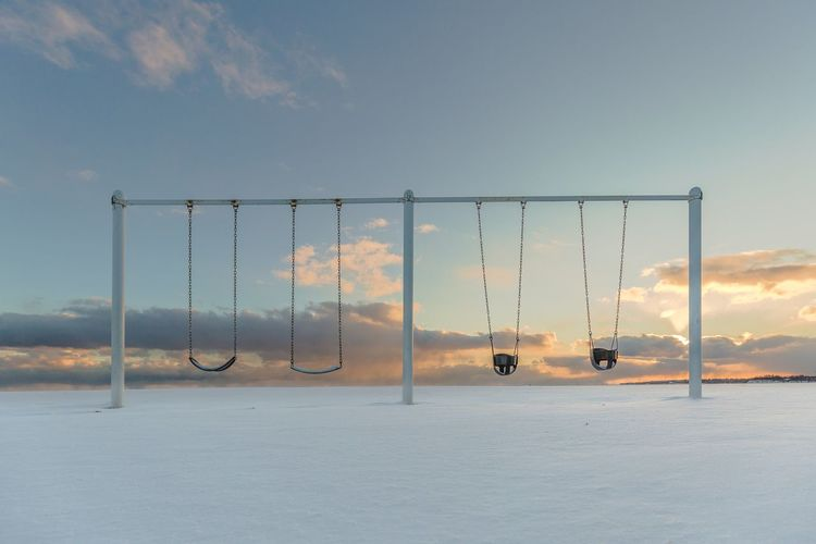 too cold to play Playground Winter Cold Temperature Cold Snow Sunset Swing Sky Clouds Water Cloud - Sky Nature Tranquility No People Sky Beauty In Nature Day Outdoors Fragility Colour Your Horizn