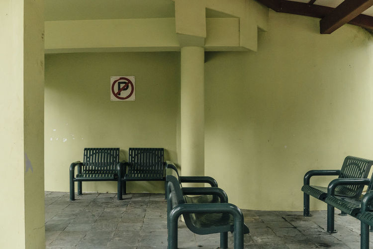 Empty chairs in covered walkway