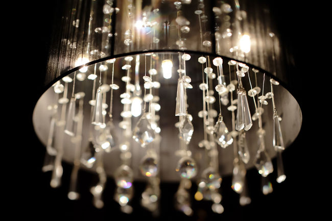 Chandelier with crystals in a nightclub Light Background Beauty Bokeh Chandelier Crystal Design Detail Diamond Elegant Glamour Glass Halogen Lamps Hang Lamp Luxury Luxury Design Luxury Hotel Luxurylife Rich Shape Style Stylish Stylish Furniture Vintage