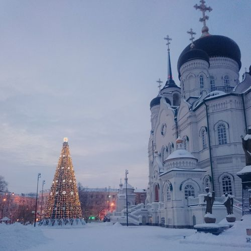 Architecture Travel Destinations Tower Tourism Built Structure Snow Building Exterior Sky Tree No People Winter Place Of Worship Outdoors Dome City Christmas Tree Nature Clock Day
