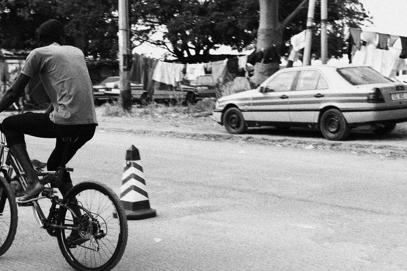 Finding New Frontiers Vintage Bicycle Gambia  Africa Blackandwhite Grainy Taxi Washline