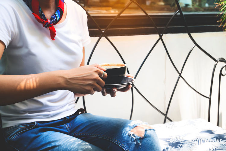 Trendy fashion jeans woman drinking coffee Casual Look Fashion Jeans Woman Advertisement Cafe Casual Clothing Coffee Coffee - Drink Coffee Break Coffee Cup Cup Day Drink Food And Drink Holding Jeans Leisure Activity Mug One Person Real People Refreshment Sitting Style T-shirt