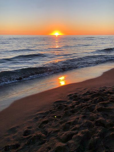 Autumn sunset Sea Beach Water Sunset Sky Beauty In Nature Land Scenics - Nature Horizon Tranquil Scene Tranquility Horizon Over Water Wave Motion Idyllic No People Orange Color Sunlight Nature