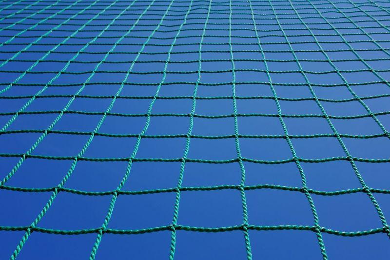 Full frame shot of net against sky