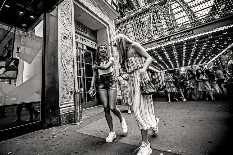 """""""Happy Moments"""" NYC LIFE ♥ NYC Photography NYC Street NY NYC Architecture Arts Culture And Entertainment Built Structure Day Leisure Activity Lifestyles Outdoors People Real People Women Young Adult Stories From The City The Street Photographer - 2018 EyeEm Awards The Art Of Street Photography My Best Photo"""