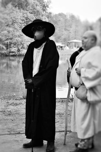 Plague doctor -2 bw Adult Clothing Day Hat Holding Incidental People Leisure Activity Lifestyles Looking At Camera Males  Men Middle Ages Mystery People Plague Doctor Portrait Real People Standing Three Quarter Length Traditional Clothing