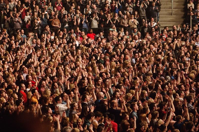 Fans applauding during popular music concert