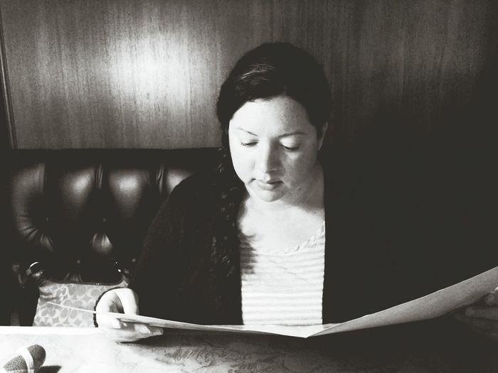 High angle view of woman looking at menu