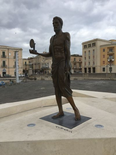 Image of Archimedes statue in Siracusa, Sicily, Italy Architecture Arcimedes Building Exterior Built Structure City Cloud - Sky Day Full Length Human Representation Italy Male Likeness Monument No People Outdoors Sculpture Sicily Siracusa Sky Statue Syracuse