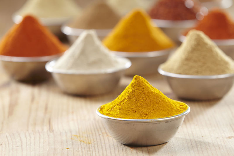 Aluminum container filled with colorful spices Chili Pepper Choice Curry Food And Drink Hot Red Spicy Aroma Assortment Cinnamon Colorful Cumin Flavor Food Ground - Culinary Ingredient No People Paprika Pepper Seasoning Spice Turmeric  Variation Wooden Background Yellow
