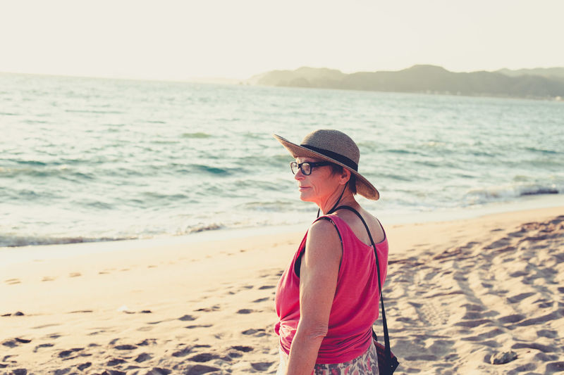 Side view of woman standing on beach