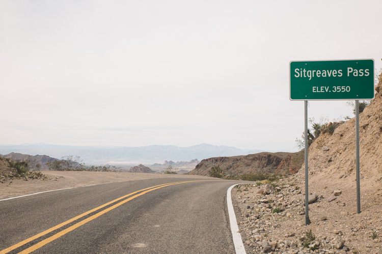 Information Sign On Road Against Clear Sky At Route 66
