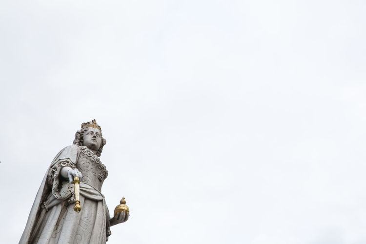 Queen Anne Statue Sculpture Representation Statue Human Representation Low Angle View Architecture Religion Queen Anne Female Likeness Sky Overcast Stone No People Famous Statue Day Natural Lighting