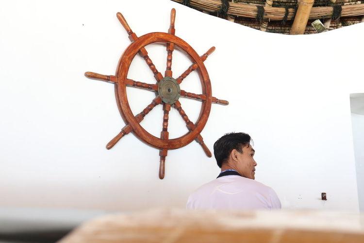 Rear view of man looking at camera