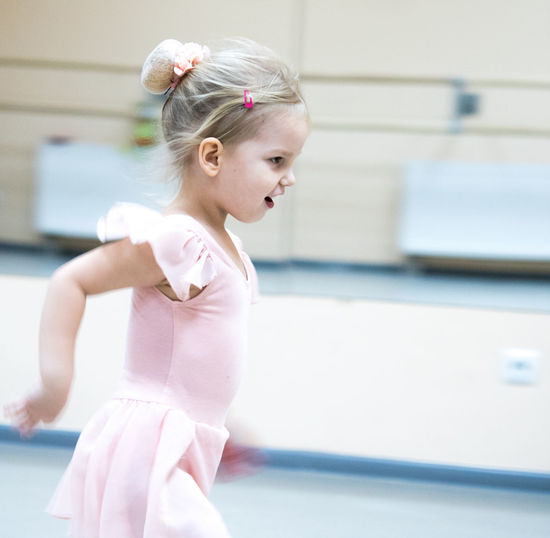Ballet Ballet Dancer Ballet Studio Child Childhood Dancing Females Girls Hairstyle Indoors  Innocence Leisure Activity Lifestyles One Person Practicing Pre-adolescent Child Preparation  Profile View Real People Skill  Standing Women