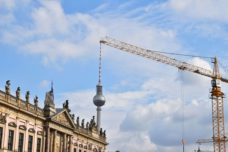 Urban geometry crossover, crane over Berlin Television Tower (Fernsehturm Berlin) Construction Fernsehturm Fernsehturm Berlin  Modern TV Tower Architecture Building Exterior Built Structure City Cloud - Sky Crane Crane - Construction Machinery Crossover Day Discover Berlin Geometry Low Angle View No People Outdoors Sky Television Tower Tourism Travel Travel Destinations Twist