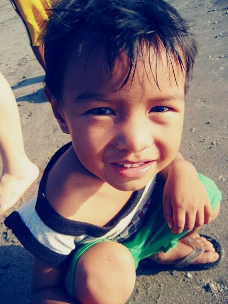 Bataan Child 2007 Sunlight Beachphotography Philippines 2007memories Childhood One Person Children Only Smiling Child One Boy Only Day Headshot Portrait Happiness Real People Beach