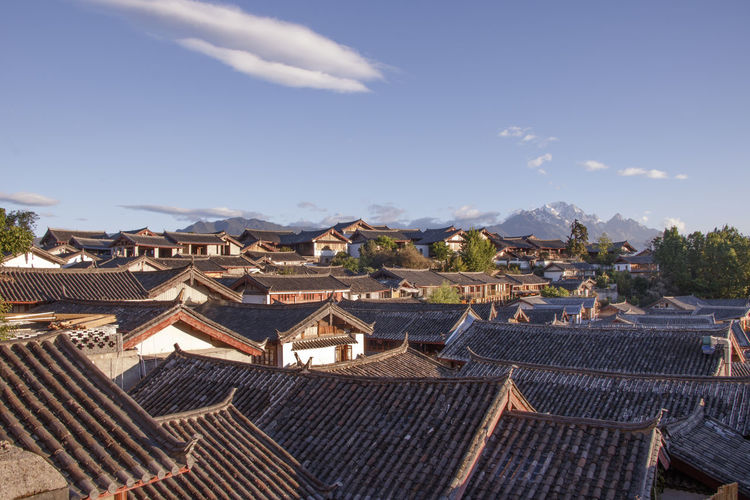 Yulong Snow Mountain Ancient Architecture ASIA Chinese China Attraction Building City Old Town Heritage Historical Oriental Vintage Retro Landmark Lijiang Yunnan Province Naxi Brick Stone Dongba Blue Sky Tree Naxi