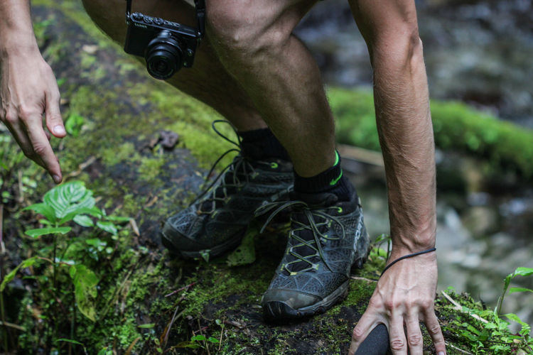 Low section of man hiking in forest