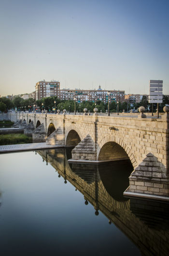 Sunrise from Madrid at Segovia Bridge and surroundings Arch Arch Bridge Architecture Built Structure Canal City Clear Sky Day Outdoors Reflection River Sky Standing Water Tourism Water