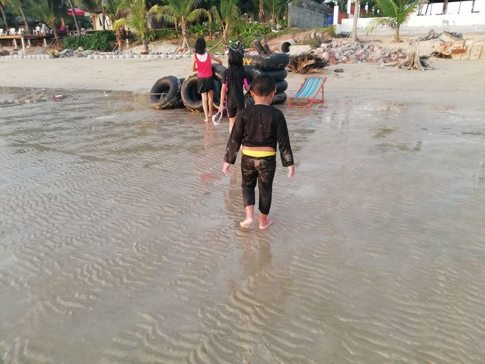 Children enjoy on summer trip 2019,หาดเจ้าหลาว Achi2019 Water Real People Lifestyles Rear View Group Of People Incidental People Day Men Childhood Nature Full Length Child Women People Walking Waterfront Leisure Activity Outdoors Rain
