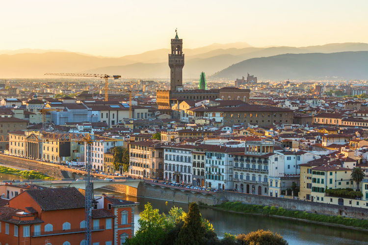 View of florence in italy at sunset by the arno river