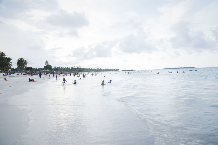 People having fun at the beach. Beach Water Sky Sea Crowd Large Group Of People Group Of People Cloud - Sky Real People Holiday Vacations Land Trip Day Nature Leisure Activity Scenics - Nature Beauty In Nature Outdoors Weekend Activities EyeEm Best Shots My Best Photo