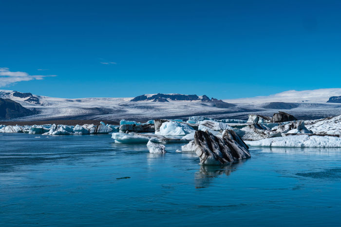 Iceland Beautifuliceland Beauty In Nature Blue Cold Temperature Environment Floating On Water Frozen Glacier Ice Iceberg Lagoon Landscape Melting Nature No People Scenics - Nature Sky Snow Snowcapped Mountain Tranquil Scene Tranquility Water Waterfront Winter