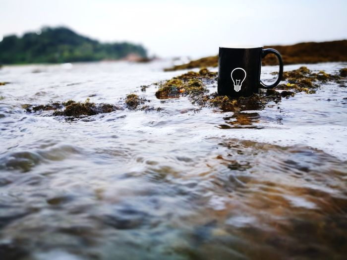 Conceptual Photo. Idea. HuaweiP9 Huaweiphotography Ocean Sea Waves Reflection Innovation Innovative Creation Creative Invention Critical Thinking Bulb Light And Shadow Light Bulb Mug Black Mug Ombak Engineering Art And Craft Art Coffee Tea Sugar Idea Water Danger Camera Film Water Pollution UnderSea