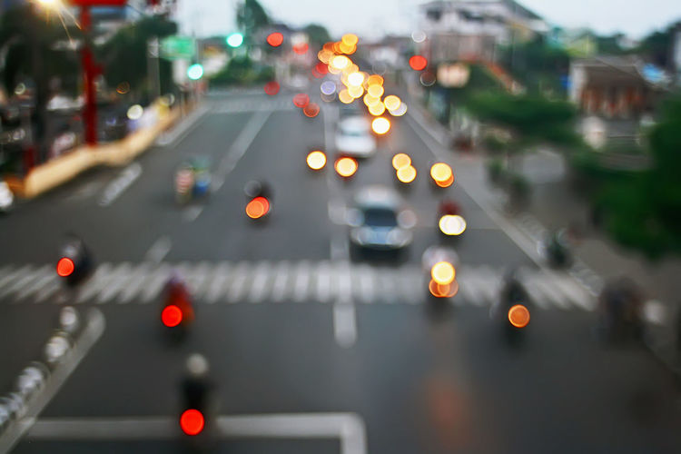 Transportation Car Motor Vehicle Road City Mode Of Transportation Street Traffic Illuminated City Street Land Vehicle City Life Motion Symbol Road Marking High Angle View Sign Blurred Blurry