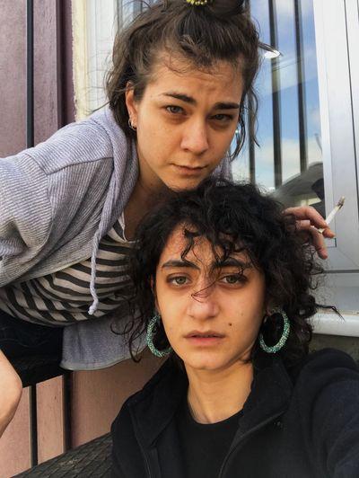 Portrait of friends against door