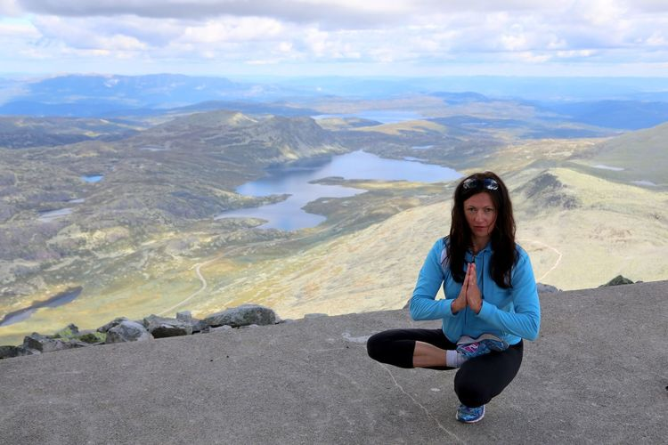 Woman doing a toestand yoga pose and meditation on top of Gaustatoppen, Telemark, Norway. Adult Beautiful People Beauty In Nature Communication Day Hatha Yoga Landscape Looking At Camera Mountain Mountain Range Nature Outdoors Peace Of Mind People Photography Themes Sitting Sky Women Yoga Yoga Outdoor Yoga Pose Yoga Post Yoga Practice Yogagirl Zehenstand