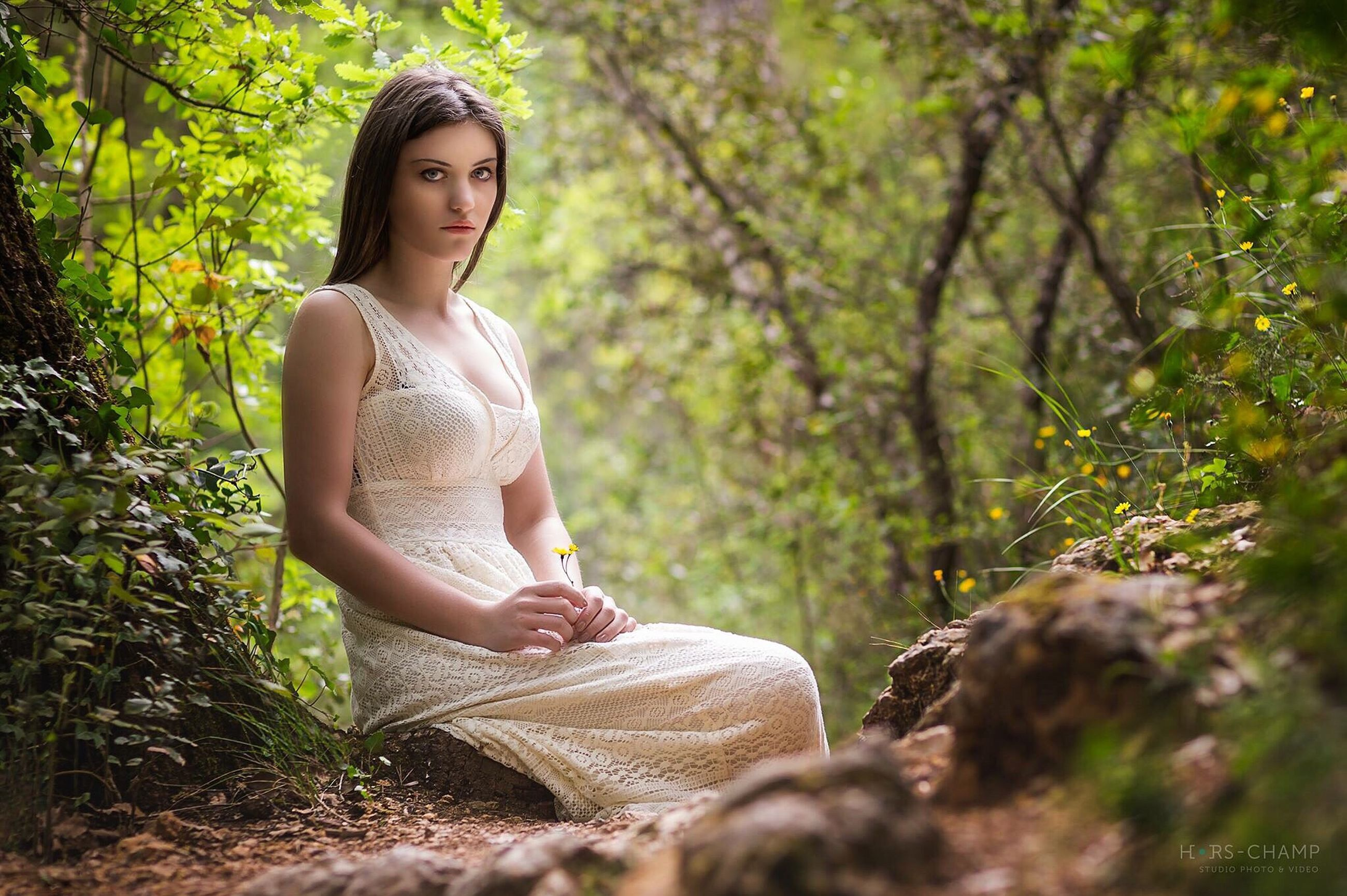 person, casual clothing, full length, lifestyles, young adult, leisure activity, tree, young women, portrait, looking at camera, forest, three quarter length, smiling, sitting, standing, front view, childhood, growth