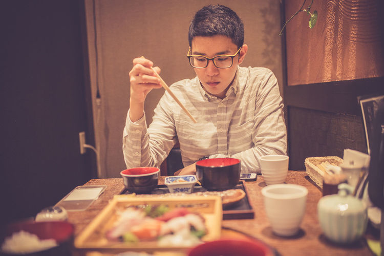 Man Having Meal While Sitting In Restaurant