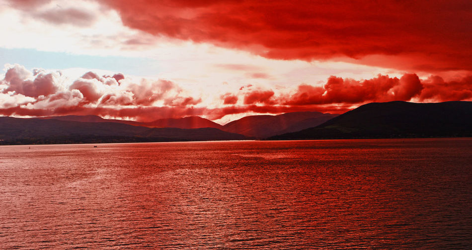 Red sky over the Orkney Islands - Scotland, UK Orkney Islands Beauty In Nature Cloud - Sky Day Idyllic Lake Mountain Mountain Range Nature No People Outdoors Red Sky Scenics Sky Sunset Tranquil Scene Tranquility Water Waterfront Red Glow