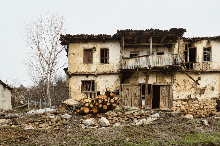 Old Village Home Abandoned Buildings Abandoned Places Architecture Building Exterior Built Structure Day Deterioration Fire Wood Firework - Man Made Object House Log Pile Logs No People Outdoors Residential Building Sky Wood - Material Wood Planks