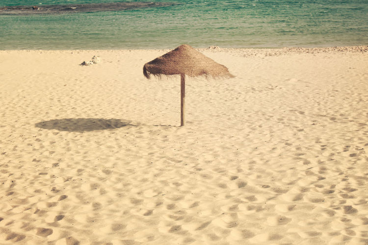 Time to relax Beach No People Outdoors Relax Relaxing Sand Shore Tranquility Umbrella