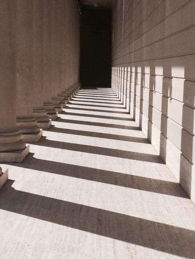 Shadow of columns on wall