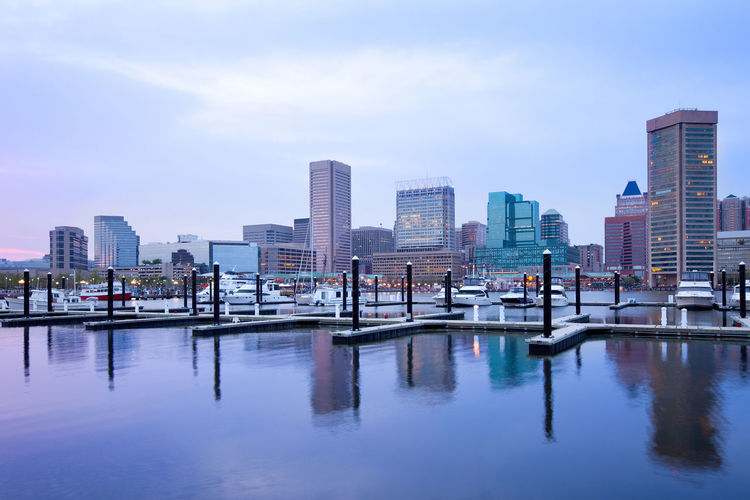 Downtown city skyline and Inner Harbor, Baltimore, Maryland, USA Baltimore Harbor Inner Harbor Maryland Skyline Architecture Building Exterior Built Structure City Cityscape Dusk Modern Outdoors Reflection Skyscraper Urban Skyline Us Water Waterfront