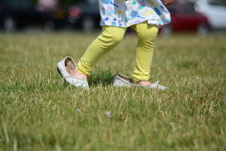 Mummys Shoes Childhood Day Grass Human Leg Low Section Outdoors People Real People Togetherness Two People Paint The Town Yellow