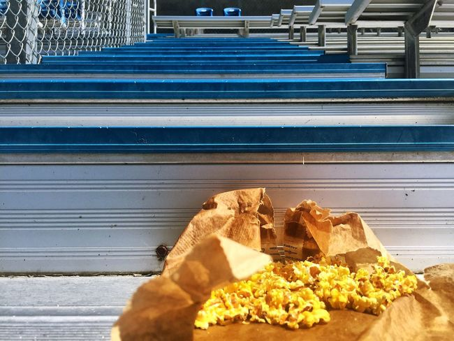 Food Food And Drink No People Snack Day Indoors  Close-up Ready-to-eat Freshness Popcorn Litter Bleachers Bleacher Seats Steps Outdoors Metal Stairs Staircase Idaho Football Metallic Bag Butter Sunlight