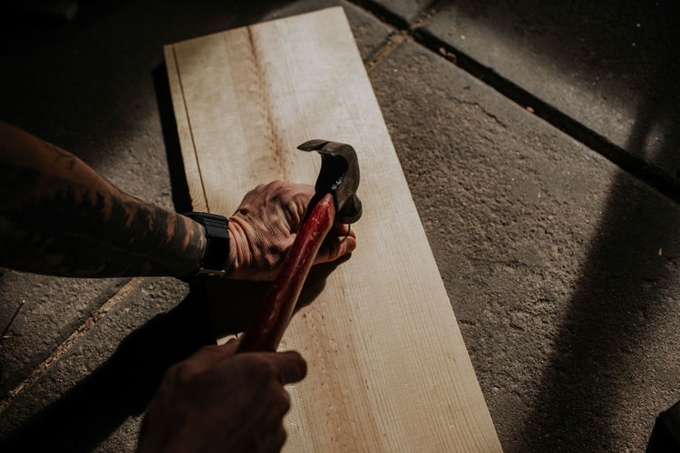 Low section of person working on wood