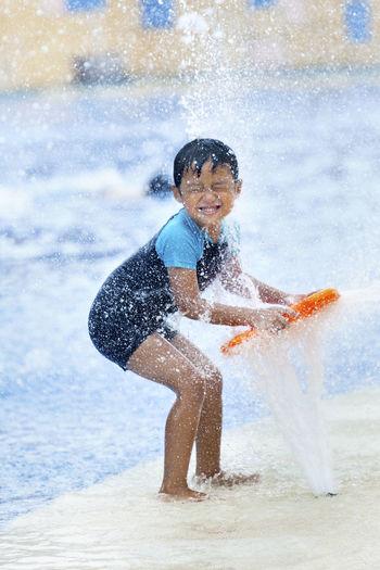 Smiling boy enjoying at water park
