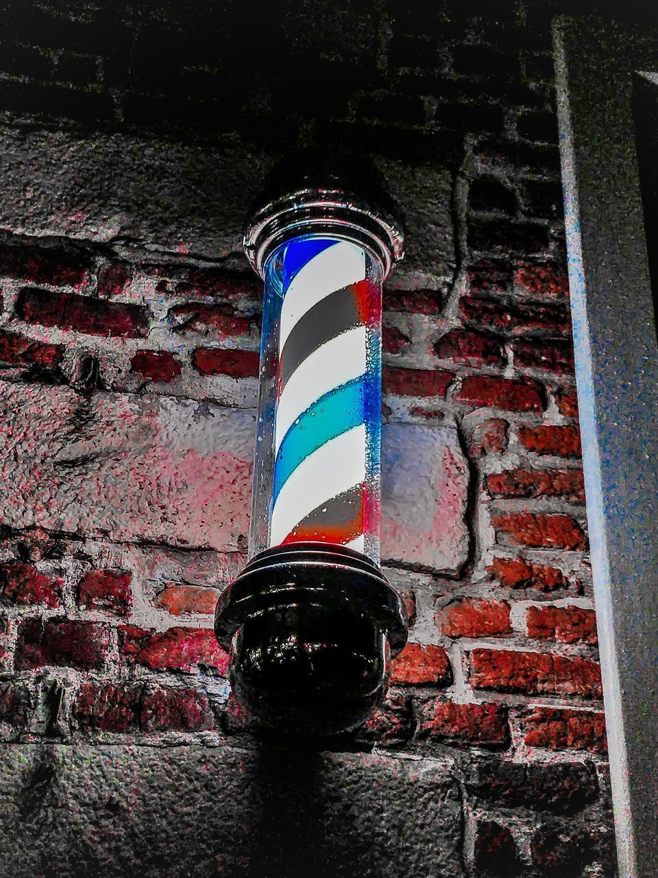red, wall - building feature, brick wall, built structure, brick, no people, wall, architecture, low angle view, striped, day, building exterior, pattern, blue, outdoors, close-up, pole, barber shop, building, shape